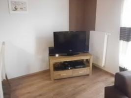 """Die Fernsehecke im Wohnbereich mit LCD-Fernseher, Hifi-Mini-Anlage mit DVD-Player und X-Box / Ferienhaus """"Ferienhaus Niels und Julia"""" in Büsum"""