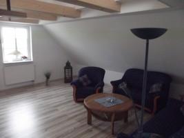 """Wohnzimmer mit TV / Ferienwohnung """"Haus Iwersen"""" in Hattstetdtermarsch"""