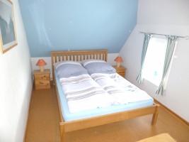 """Schlafzimmer Bett 1,40 x 2,00 m / Ferienhaus """"Ferienhaus Nis Puk"""" in Bordelum"""