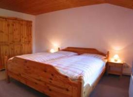"""Schlafzimmer mit Doppelbett / Bauernhof/Ferienhof """"Ferienwohnung auf dem Bauernhof"""" in Nordstrand"""