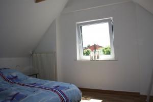 """2. Schlafzimmer im Obergeschoss. / Ferienhaus """"DEKO"""" in Husum"""