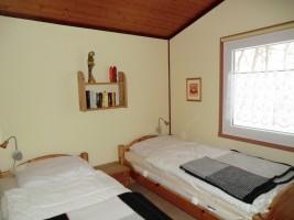 """Schlafzimmer mit zwei Einzelbetten / Ferienhaus """"Haus Nixe"""" in Simonsberg"""