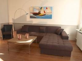 """Wohnzimmer zum Relaxen / Ferienhaus """"Stadthuus 51"""" in Husum"""