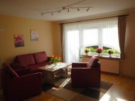 """Gemütliches Wohnzimmer mit TV / Ferienwohnung """"Urlaub bei Familie Boockhoff"""" in Drelsdorf"""