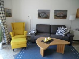 """Sitzgelegenheiten zum Entspannen / Ferienhaus """"Muschelsucher 1"""" in Nordstrand-Norderhafen"""