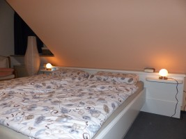 """Schlafzimmer / Ferienhaus """"Muschelsucher 1"""" in Nordstrand-Norderhafen"""