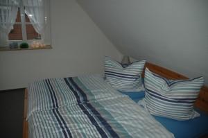 """Einfach ausschlafen / Ferienhaus """"Muschelsucher 2"""" in Nordstrand-Norderhafen"""