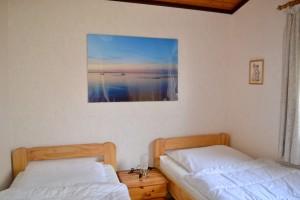 """Schlafzimmer 1 / Ferienhaus """"Ferienhaus Simi ruhig gelegen hinter dem Nordseedeich"""" in Simonsberg"""