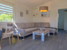 """Wohnzimmer """"Gode Stuv"""" / Ferienhaus """"Ferienhaus Wattküken an der Nordsee, Urlaub mit Hund, WLAN"""" in Simonsberg"""